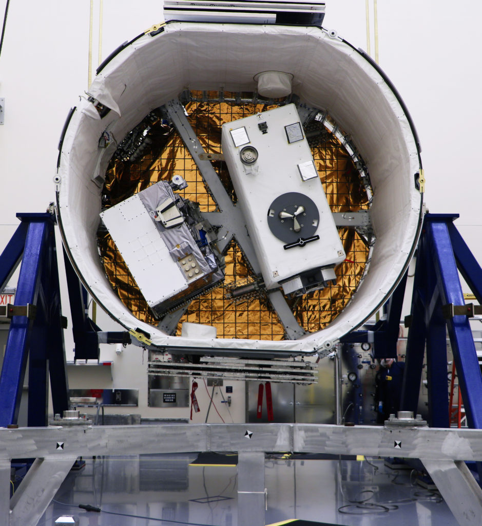The Robotic Refueling Mission 3 (RRM3), at left, and the Global Ecosystem Dynamics Investigation (GEDI) are in the SpaceX Dragon unpressurized trunk.