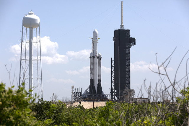 A SpaceX Falcon Heavy rocket is ready for launch on the pad