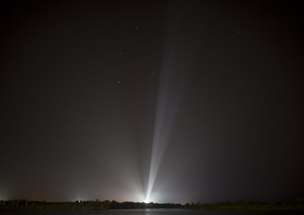 A SpaceX Falcon Heavy rocket carrying 24 satellites as part of the Department of Defense's Space Test Program-2 (STP-2) mission is seen illuminated by lights at Launch Complex 39A, Monday, June 24, 2019 at NASA's Kennedy Space Center in Florida.