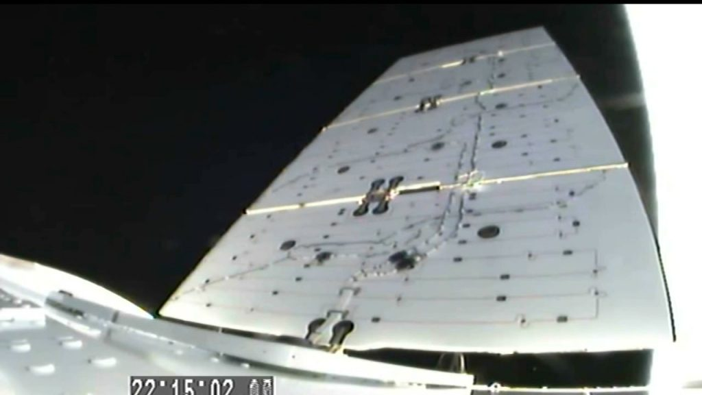 Dragon's solar arrays deploy on its journey to the International Space Station July 25, 2019.