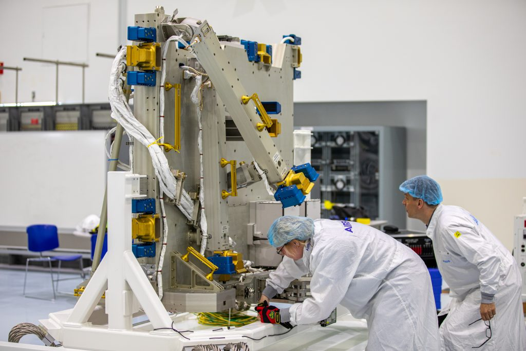 Airbus workers unpack the Bartolomeo platform in the Space Station Processing Facility high bay at NASA's Kennedy Space Center in Florida on Jan. 30, 2020.