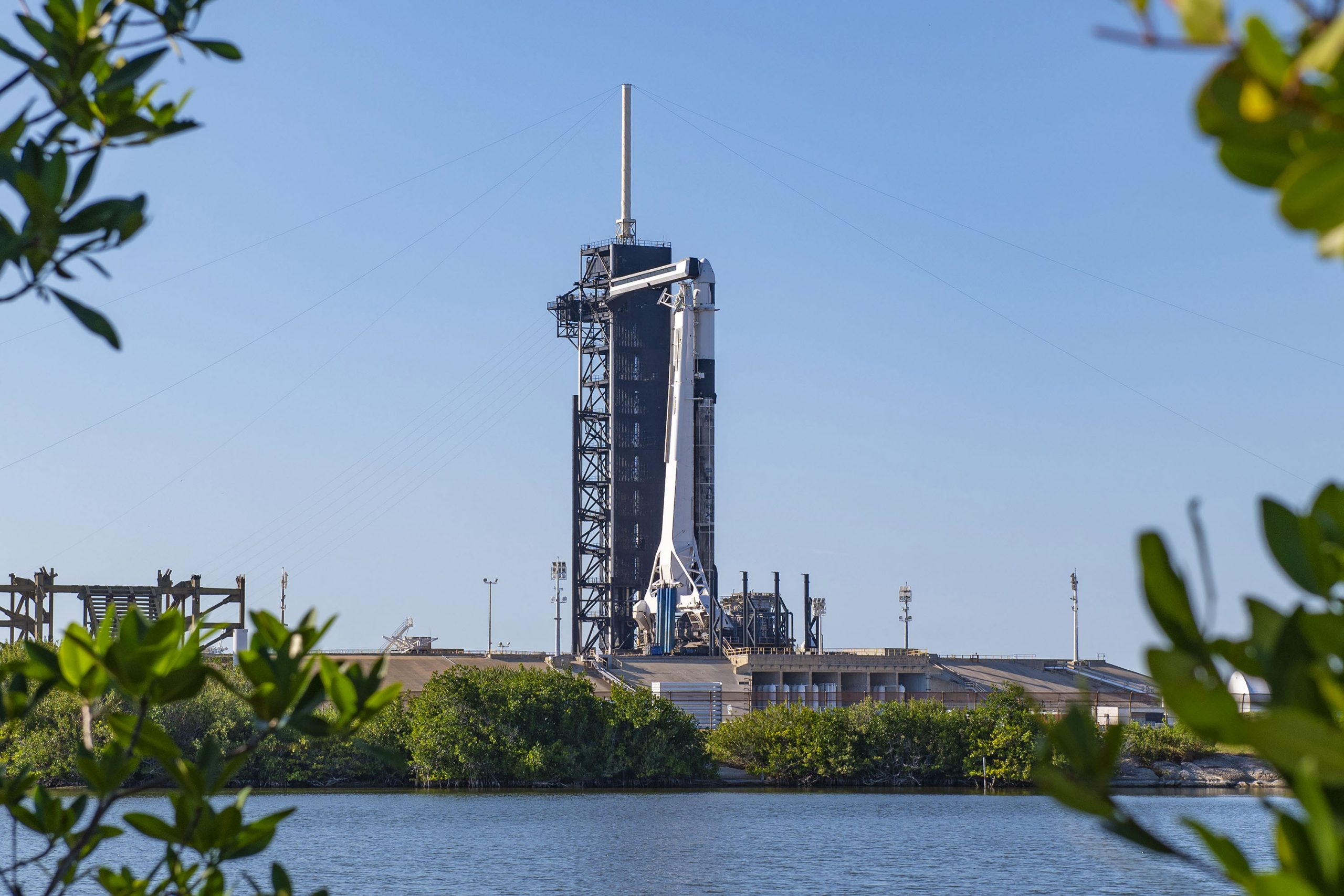 A SpaceX Falcon 9 rocket and cargo Dragon spacecraft stand ready for liftoff for the company's CRS-21 mission on Dec. 6, 2020.