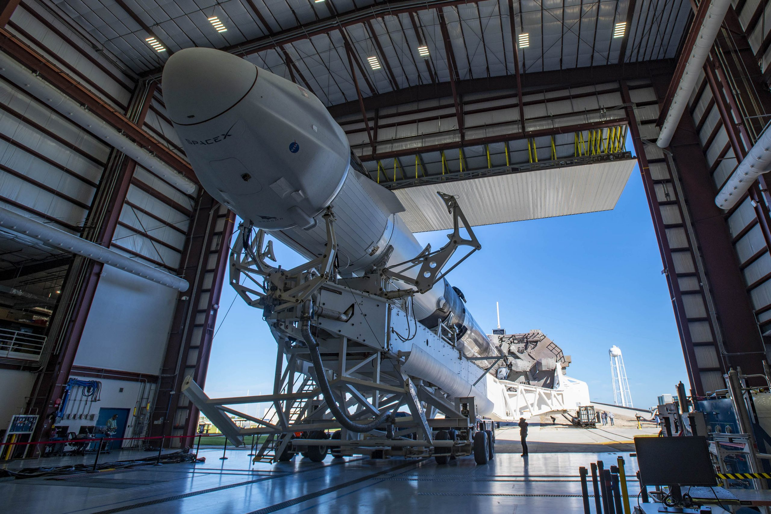 Falcon 9 and Cargo Dragon prepare to roll out to the launch pad for CRS-21.