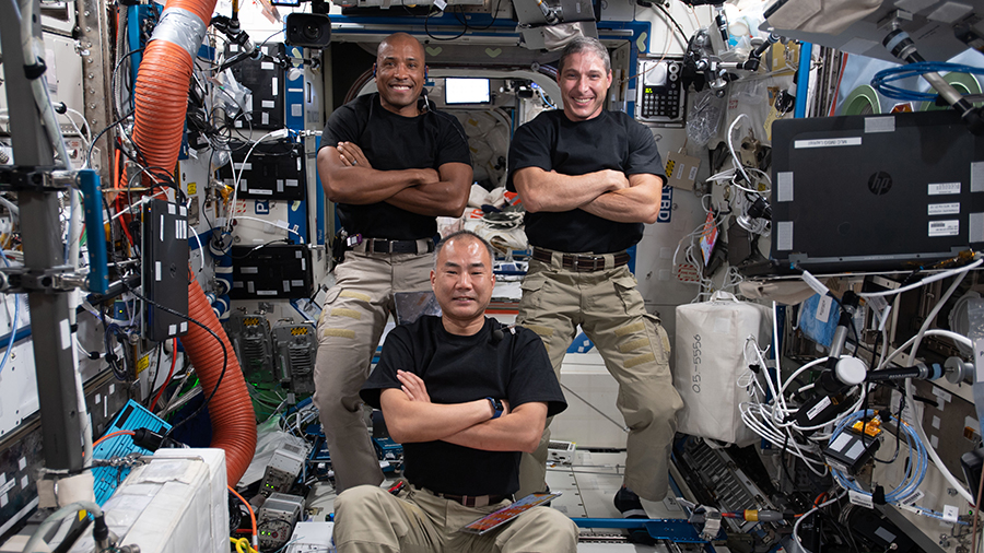 Expedition 64 Flight Engineers (clockwise from top left) Victor Glover, Michael Hopkins and Soichi Noguchi pose together for a playful portrait inside the U.S. Destiny laboratory module.