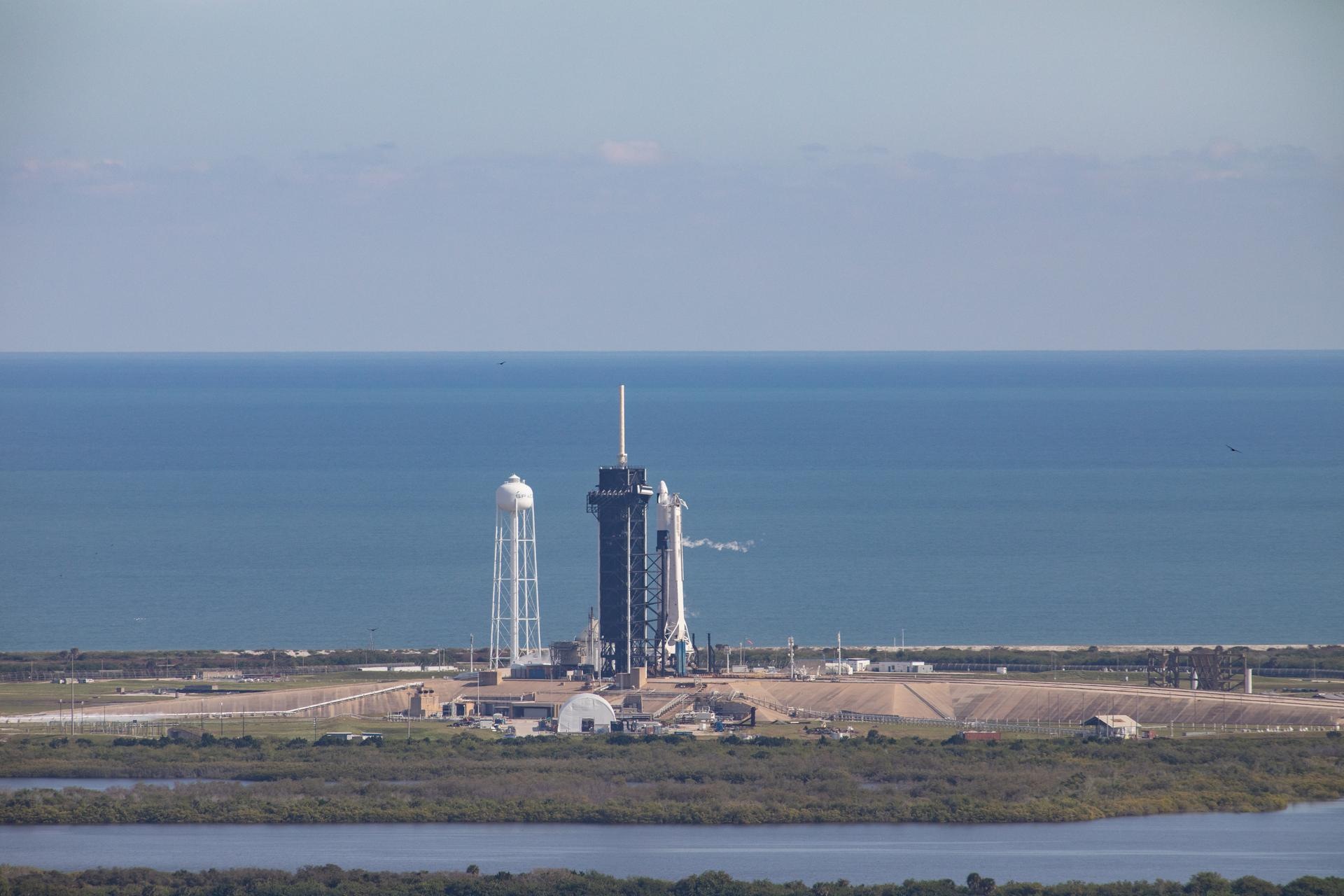 A SpaceX Falcon 9 rocket and uncrewed Cargo Dragon just before liftoff at Kennedy's Launch Complex 39A.