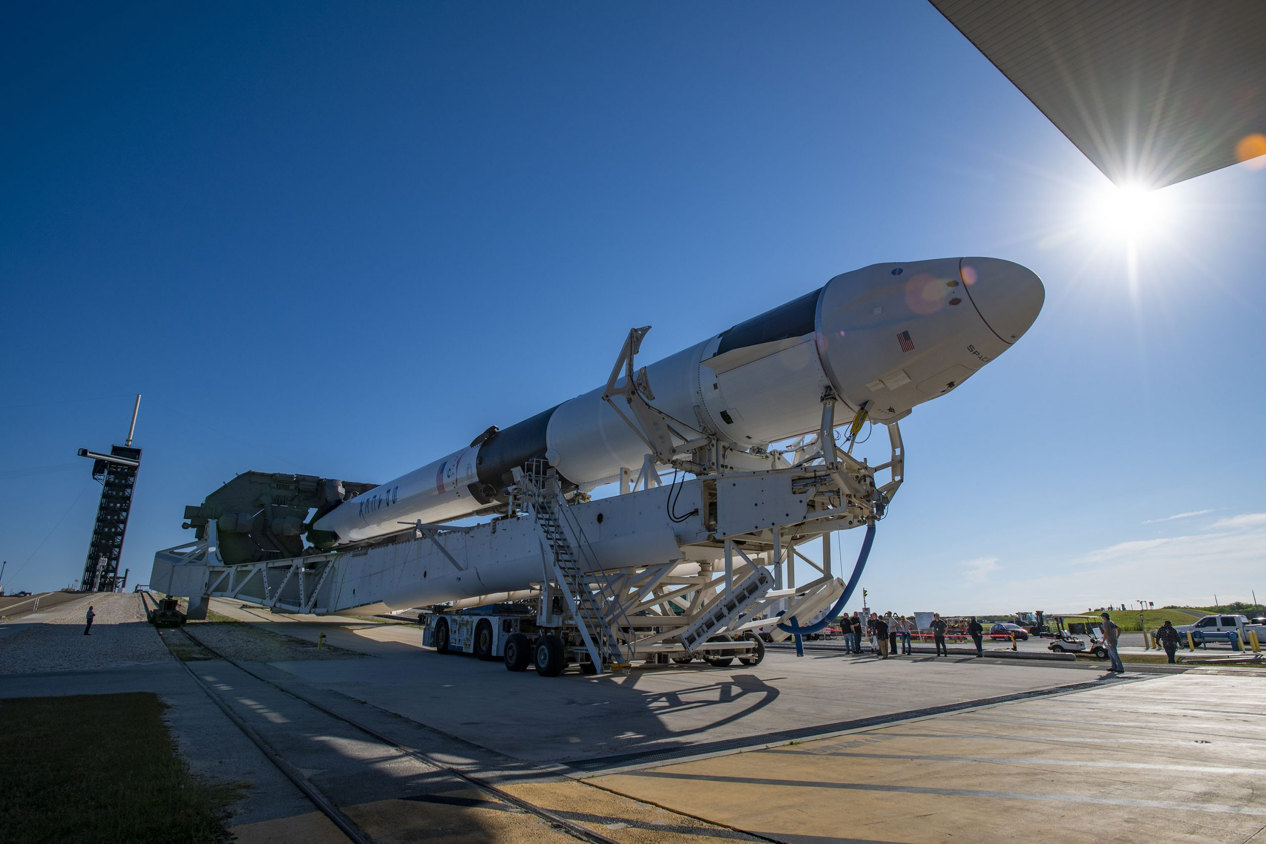 The SpaceX Falcon 9 rocket and Dragon spacecraft are rolled out to the launch pad in preparation for the CRS-22 mission.