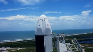 An up-close view of the Dragon spacecraft atop SpaceX's Falcon 9 rocket at Launch Complex 39A.
