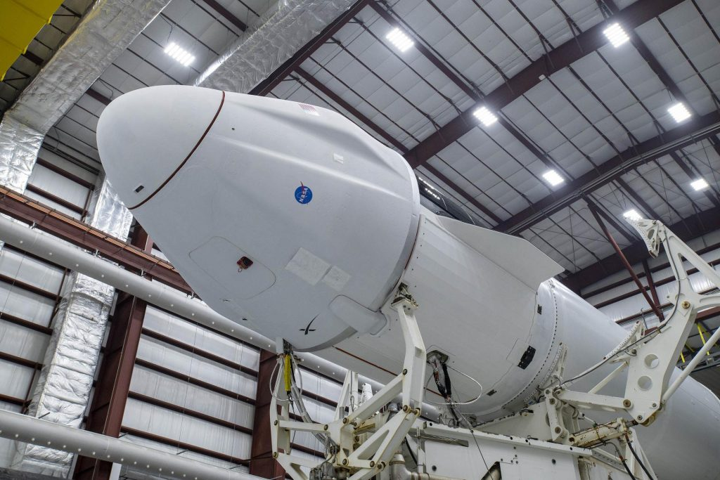 SpaceX Dragon capsule atop the company's Falcon 9 rocket at Kennedy Space Center