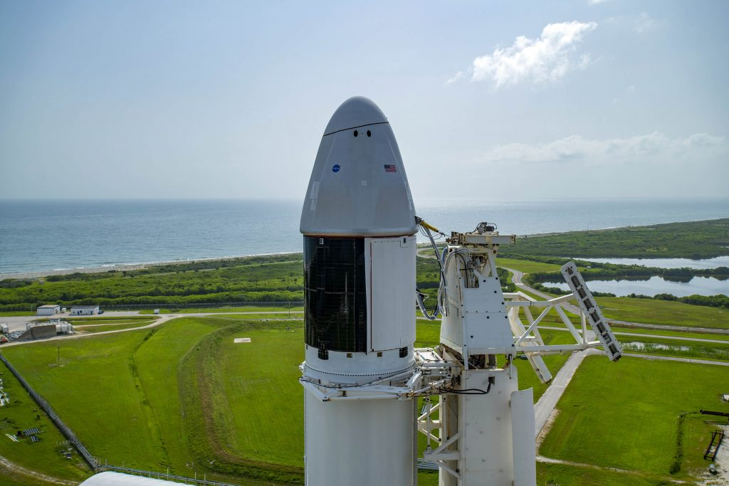 CRS-23: SpaceX Dragon spacecraft atop the company's Falcon 9 rocket