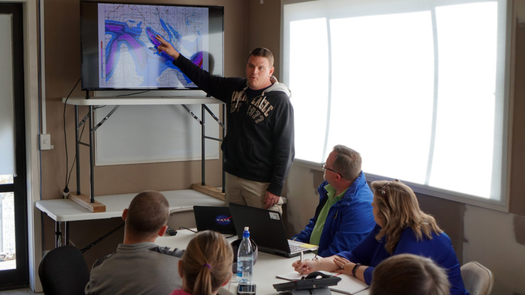 Chris Schwantes, meteorologist with NASA's Columbia Scientific Balloon Facility, provides a daily weather briefing to the super pressure balloon team March 30 at Wanaka Airport, New Zealand. (NASA/Bill Rodman)