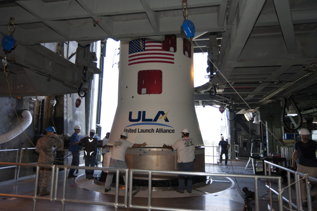 At the Vertical Integration Facility at Space Launch Complex 41 at Cape Canaveral Air Force Station in Florida, United Launch Alliance team members mate a Centaur upper stage to an Atlas V booster. The rocket is scheduled to launch the Tracking and Data Relay Satellite, TDRS-M.
