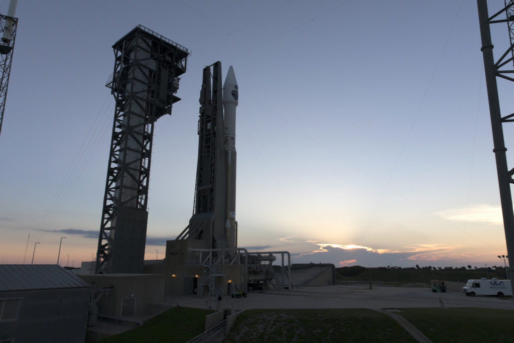 The United Launch Alliance Atlas V rocket carrying NASA's TDRS-M spacecraft is lit by the rising sun at Cape Canaveral Air Force Station's Space Launch Complex 41 on Thursday, Aug. 17.
