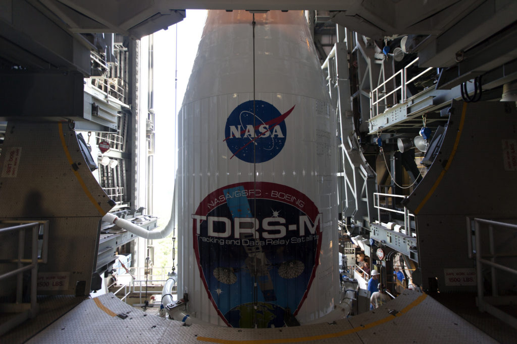 The payload fairing containing the Tracking and Data Relay Satellite-M (TDRS-M) is in place atop a United Launch Alliance Atlas V rocket at Cape Canaveral Air Force Station's Space Launch Complex 41.