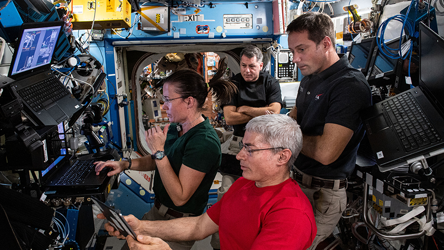 (Clockwise from bottom) Expedition 65 Flight Engineers Mark Vande Hei, Megan McArthur, Shane Kimbrough and Thomas Pesquet participate in robotics training to support the solar array installation spacewalks.