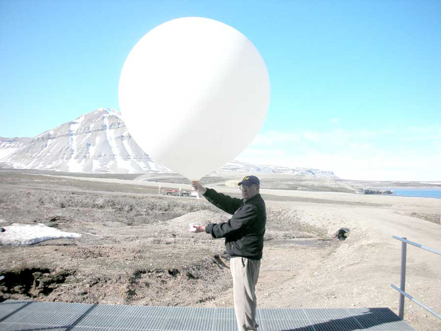NASA Ames Center Director Pete Worden holding a balloon at Svalbard