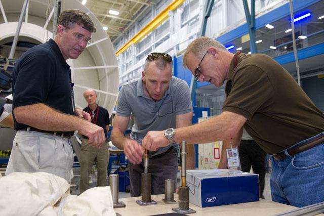 JSC2012-E-211701 -- NASA astronauts Steve Bowen, Andrew Feustel and David Wolf