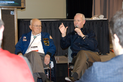 Bruce McCandless and Brian Duffy talking to students and volunteers.