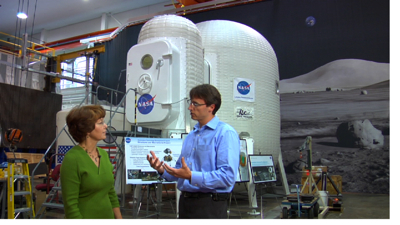 Chris is learning more about the Inflatable Lunar Habitat concept from Karen Whitley.