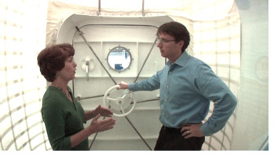 Karen Whitley and Chris inside the airlock section of the hab.