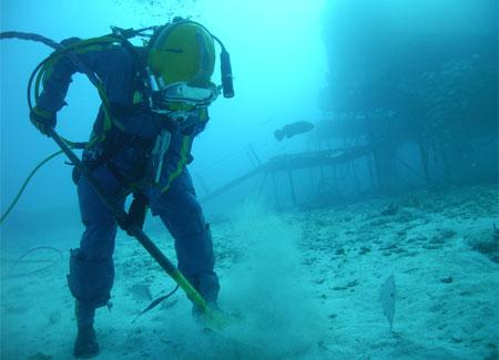 Aquanaut shoveling underwater