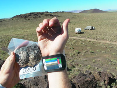Stan Love holding up sample rock