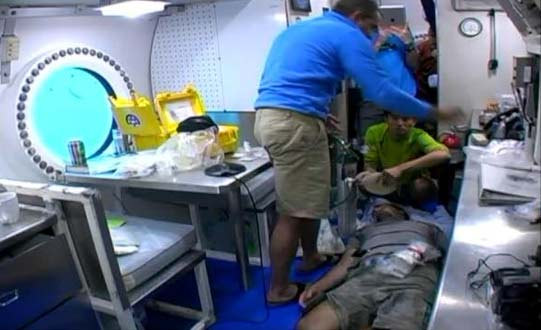 The NEEMO 15 crew simulates a behavioral health assessment scenario