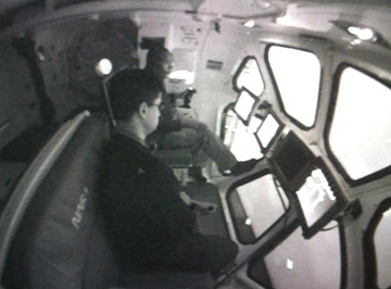 Crewmates José Hurtado and Alvin Drew participate in an MMSEV             flying simulation.