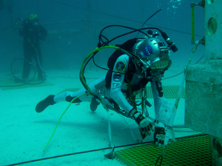 Aquanaut Tim Peake prepares to anchor so he has a stable platform from which to gather samples