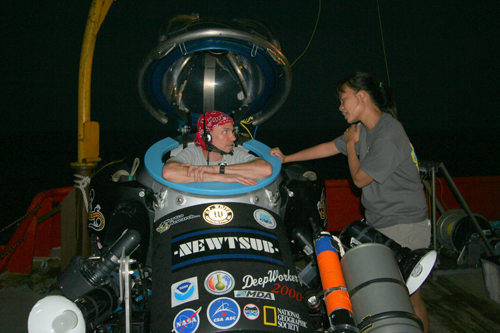 Image of Dr. Love preparing for a night flight in the deepworker sub. Darlene Lim also pictured.