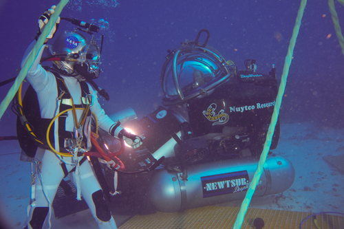 Photo of aquanaut and DeepWorker sub piloted by astronaut Mike Gernhardt