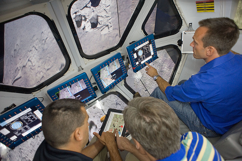 RATS crew members see a visualization of asteroid Itokawa from the windows of the Multi-Mission Space Exploration Vehicle (MMSEV). Photo credit: NASA
