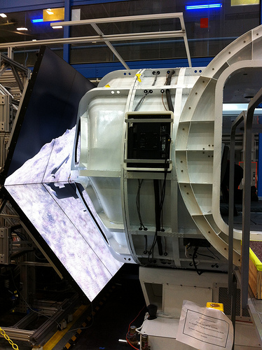 The Multi-Mission Space Exploration Vehicle (MMSEV) viewed from outside during the RATS simulated mission; video screens in front of the MMSEV windows project images of the asteroid as crew members pilot the MMSEV. Photo credit: NASA