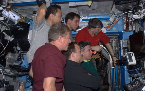 Expedtion 28 Crew Watching Launch of Atlantis
