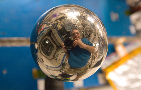 ISS030-E-175968 -- Reflection in a metal sphere.