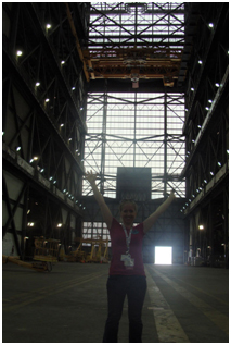 Mindi Capp stands inside a large building
