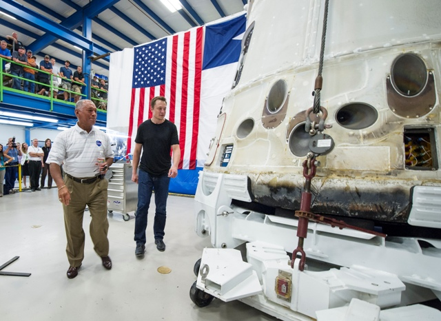 NASA Administrator Charles Bolden, left, and SpaceX CEO and Chief Designer Elon Musk, view the historic Dragon capsule that returned to Earth on May 31 following the first successful mission by a private company to carry supplies to the International Space Station on Wednesday, June 13, 2012 at the SpaceX facility in McGregor, Texas.  Bolden and Musk also thanked the more than 150 SpaceX employees working at the McGregor facility for their role in the historic mission. Photo Credit: (NASA/Bill Ingalls)