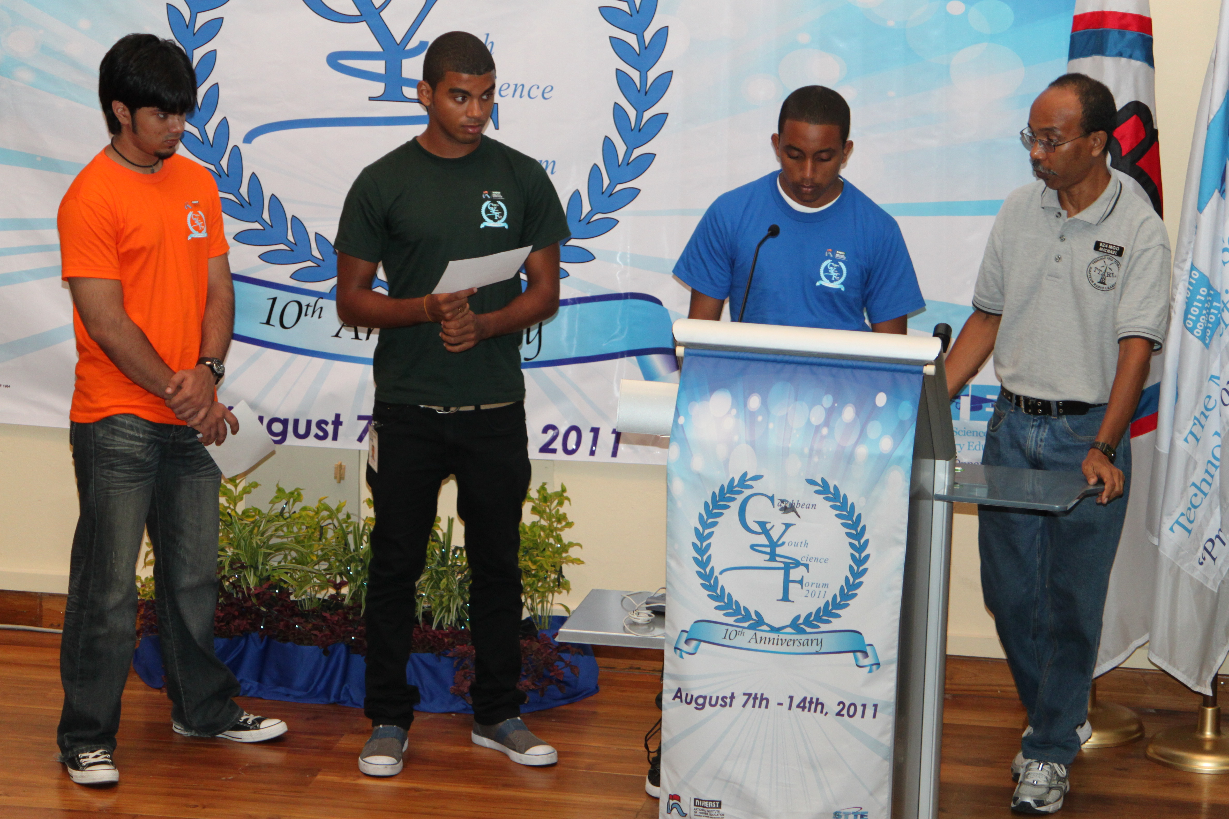 major competition stations ham radio Students asking Satoshi Furukawa their questions. Fromleft to right:  Jonathan Gosyne, Presentation College Chaguanas; Adam Hanna,Queen's Royal  College; ...