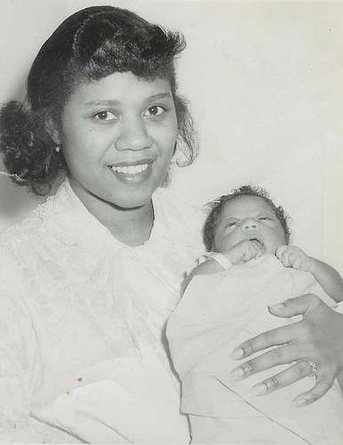 Young Harriette holding newborn CIO Linda