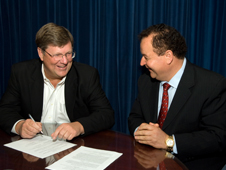 Goddard Center Director Rob Strain (left) and SEEC President Kam Ghaffarian sign the Space Act Agreement. Credit: NASA/Bill Hrybyk