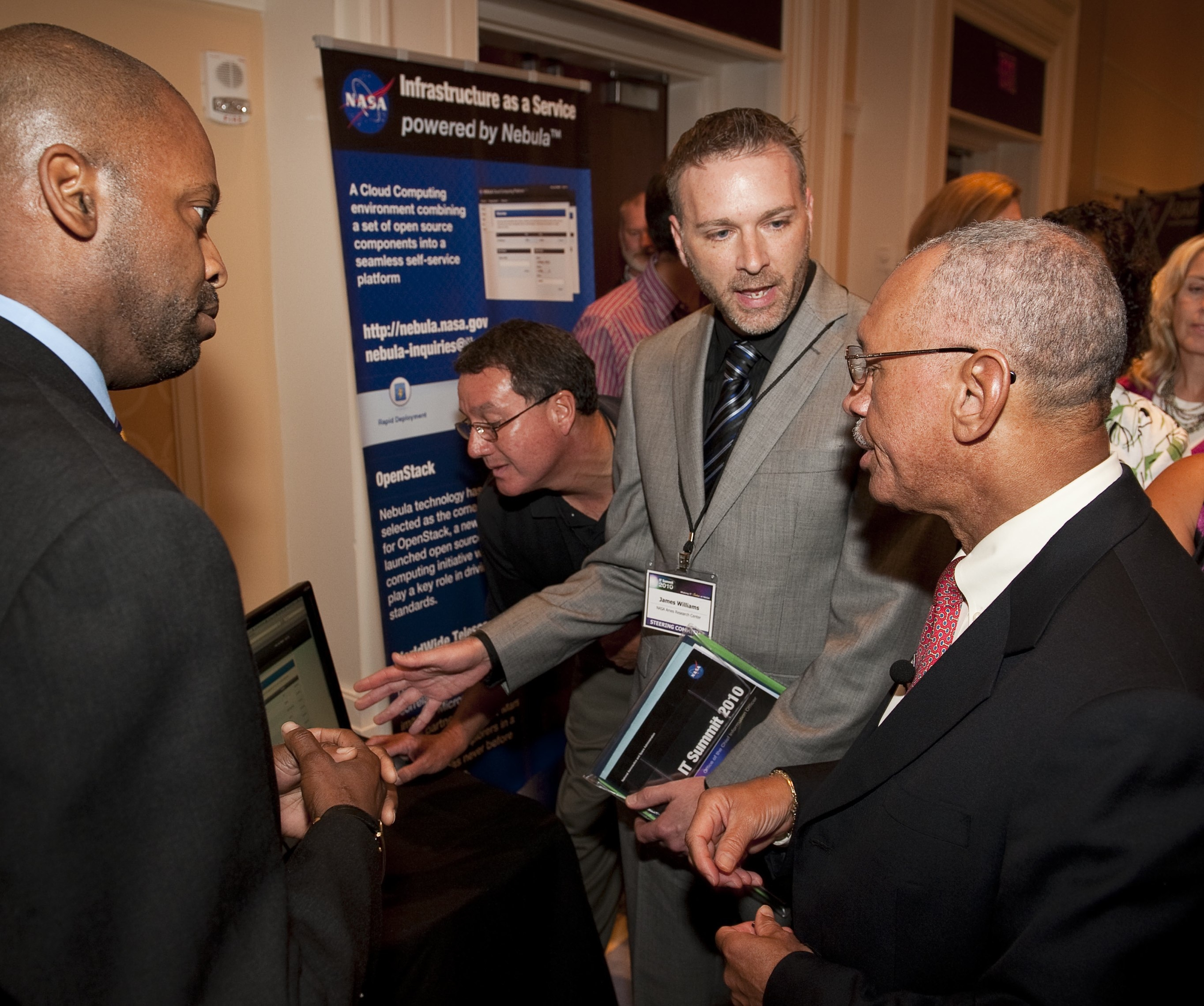 GSFC CIO Adrian Gardner and ARC CIO James Williams discussing NASA Cloud Services with NASA Administrator Bolden