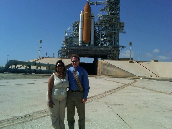 Kennedy Space Center CIO Mike Bolger with NASA CIO Linda Cureton with Space Shuttle in background