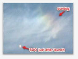 Solar Dynamics Observatory at launch just before it passes through the sundog.