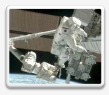 STS-133 astronaut conducting a spacewalk outside the ISS