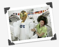 Astronaut Catherine Coleman poses with Robonaut 2