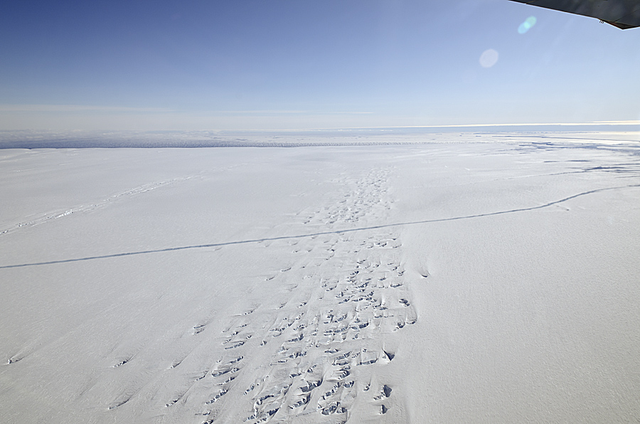 A crack runs across the floating ice shelf of Pine Island Glacier in Antarctica, seen from NASA's DC-8 on Oct. 14, 2011