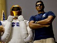 Sandeep Yayathi poses beside Robonaut 2