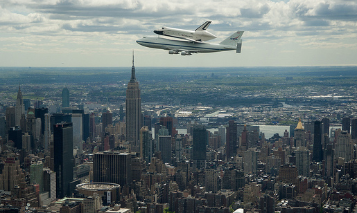 Enterprise mounted on NASA's 747 Shuttle Carrier Aircraft flying over New York City.