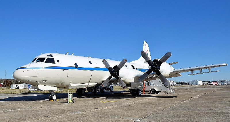 The P-3B on the ramp before a test flight. The antennas of the ice-penetrating radar system can be seen mounted under the wings.
