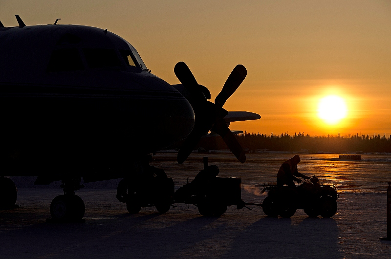 The NASA P-3 aircraft is being prepared on a chilly morning for a sea ice mission over the Beaufort and Chukchi Seas from Fairbanks, Alaska. Photo: Michael Studinger/NASA.