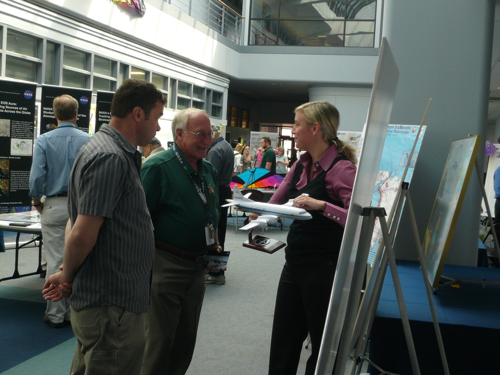 IceBridge project scientist Michael Studinger (left) and project manager Christy Hansen (right) at the Operation IceBridge display table